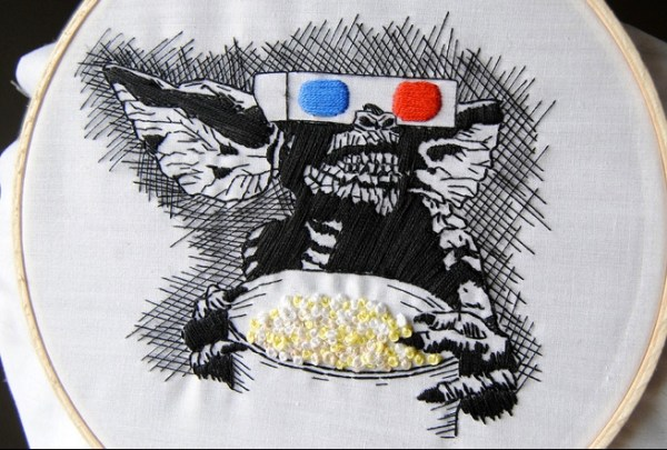 Gremlins, with popcorn. Hand Embroidery.