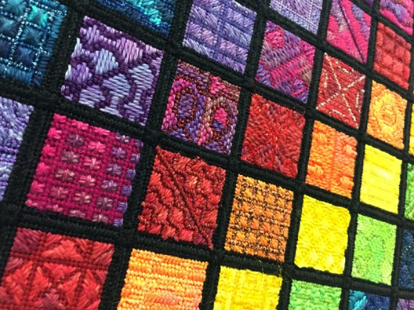 Can you spot the different types of fibers in this design? In any kind of fiber art and needlework, they are chosen to create texture and dimension. A metallic contrasting with cotton, for instance, adds variety and visual interest.