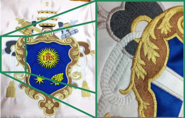 Overlapping details in heraldic banner embroidery by Erich Campvell