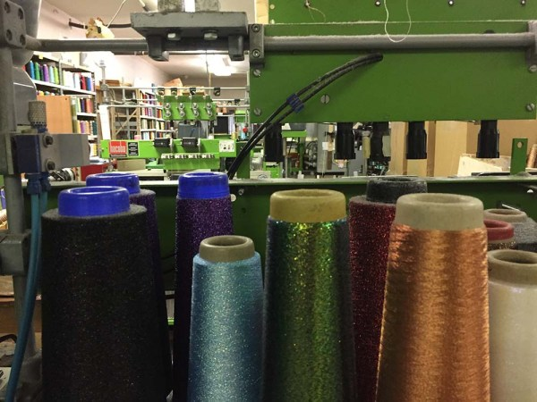 After a day's work, the area was pretty quiet. Wouldn't be long, though before the braiding, coning, spooling, labeling, and packaging would begin. Imagine the sounds of thread being made for you.