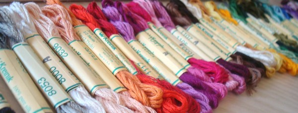 """Notice the """"A"""" on some of the labels of these Kreinik Silk Mori skeins? That indicates a new dye lot. Check labels on all of your threads to see if there is a dye lot designation."""