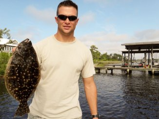 Kyle Perry caught this nice flounder fishing the down current side of a boat dock in Fort Bayou.