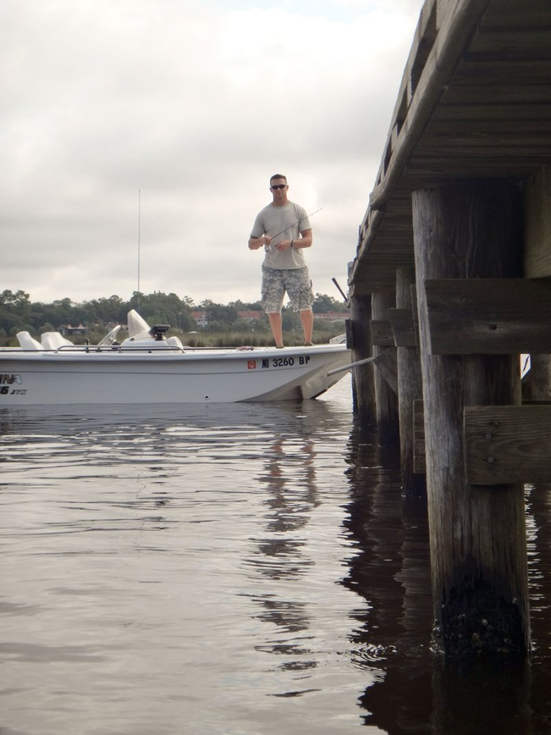 Kyle Perry positions his boat so that he can work his lure past every pier piling, since each is a potential flounder hiding spot.