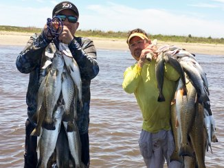 Sammy Romano, left, and Cabot Corso enjoyed an epic day in the surf last April, catching limits of specks using suspended jerkbaits.