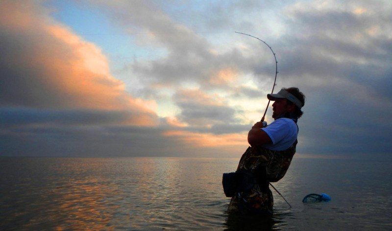 Wading and casting the shoreline of Chandeleur Island can put a fisherman in a battle with a bull redfish at any moment, especially at sunrise.