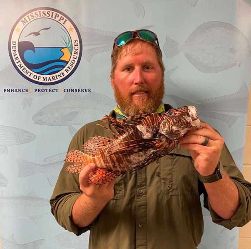 Heath Powell with his record Red Lionfish. (Photo courtesy MDMR)