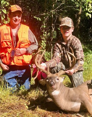 Gray Worthey and his deer with Brad Whittington, who helped track down the monster with his Bavarian Mountain Hound, Boone.