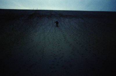 Person climbing sand dunes, Empire, Michigan