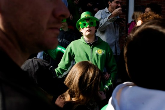 People watch the St. Patrick's Day Parade in South Boston, Massachusetts.