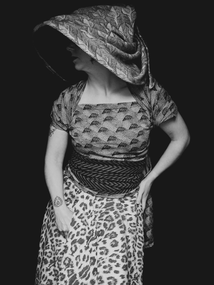 a white woman dressed in black and white wraps