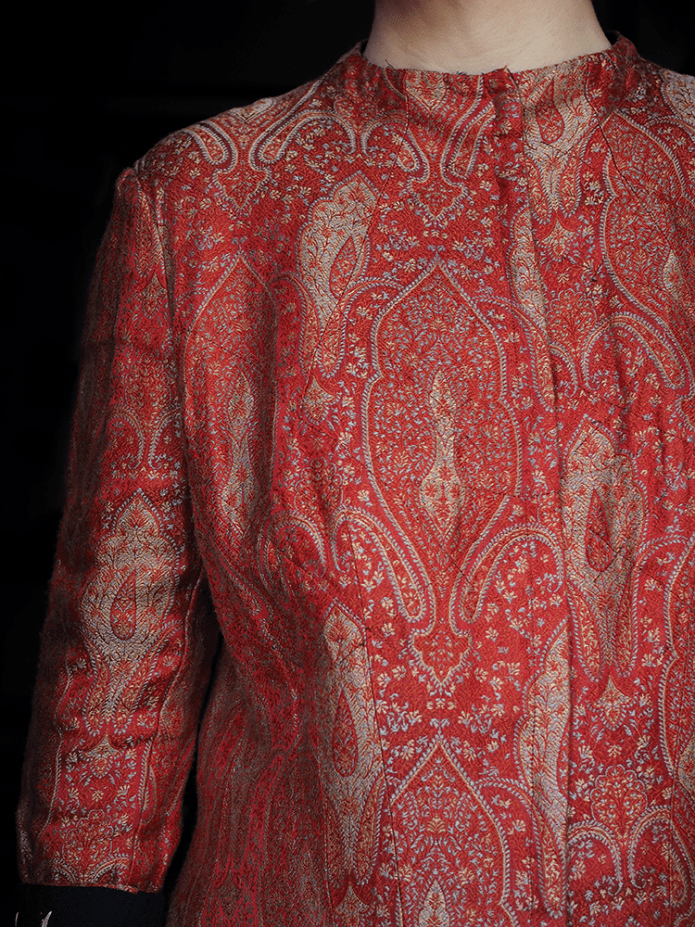neckline of the red silk jacket