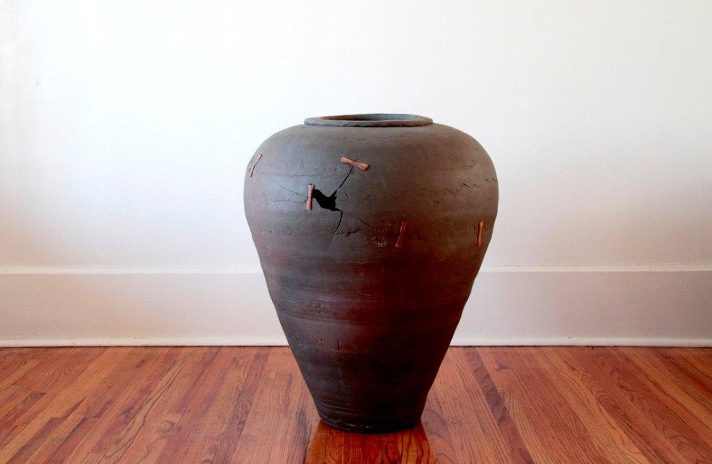 broken and repaired vase