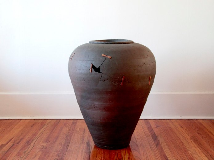 broken and repaired vase