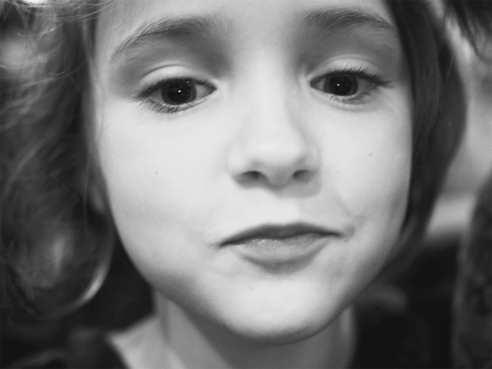 black and white close up of a young girl