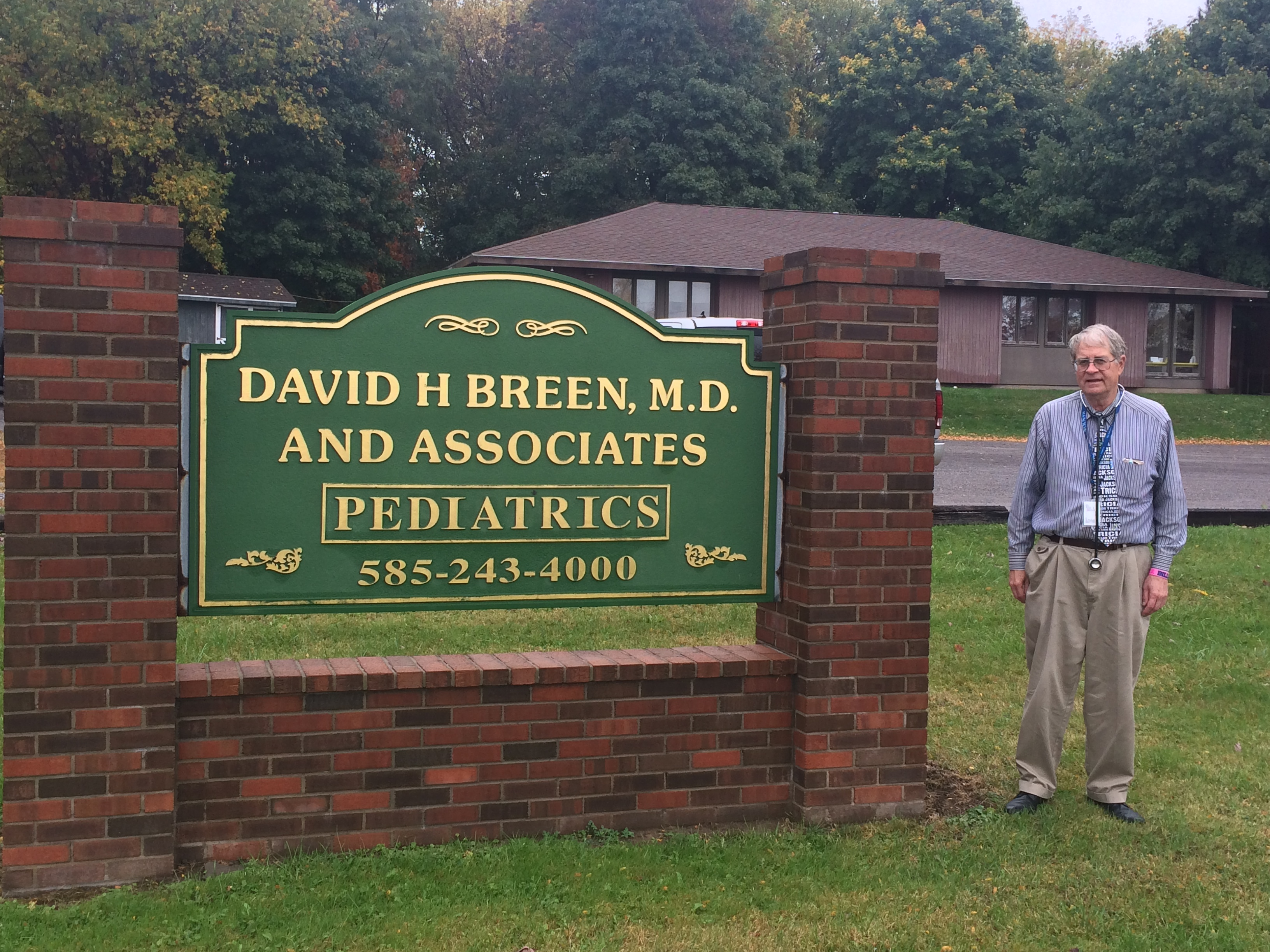 Dr. Breen in front of Geneseo office