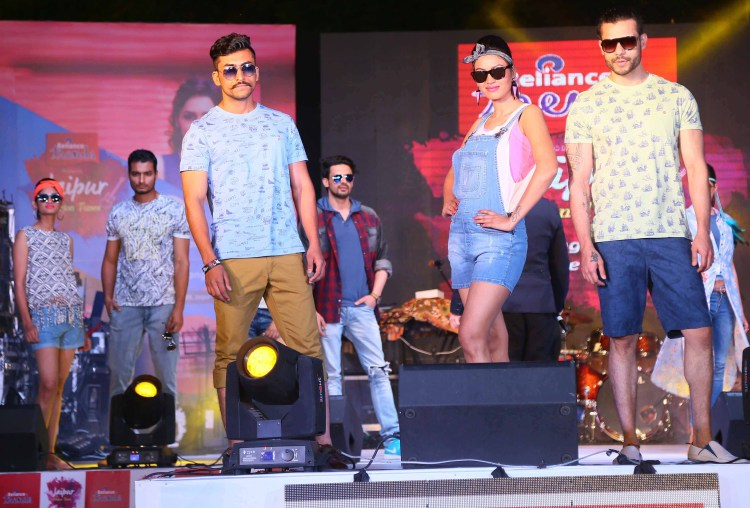 Models showcase the S\S 16 collection of Reliance Trends at the show