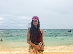A girl in front of the waves of Malapascua beach