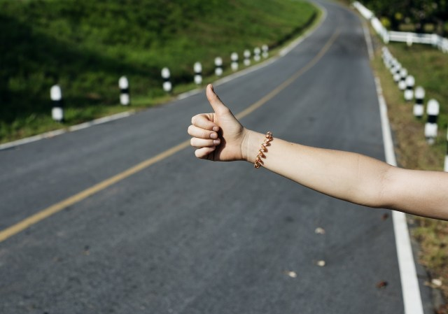 hitch hiking along the road
