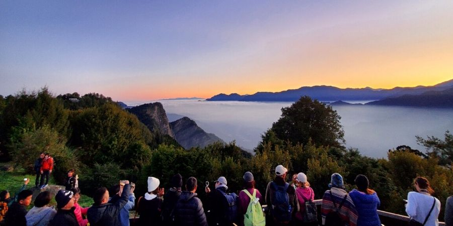 Visitors patiently wait for the famous Alishan sunrise at Mount Ogasawara Viewing Lot.
