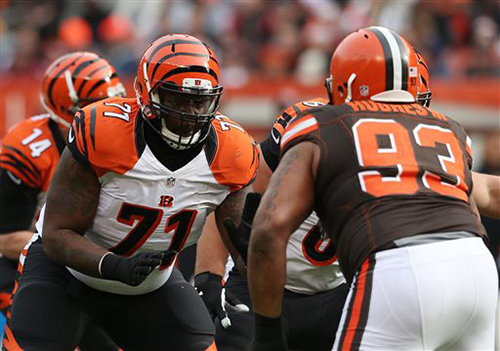 In this Dec. 6, 2015, file photo, Cincinnati Bengals offensive tackle Andre Smith (71) gets set to block against Cleveland Browns defensive end John Hughes (93) during the first half of an NFL football game  in Cleveland. Smith, a free agent, agreed to terms on a one-year deal with the Minnesota Vikings, Thursday, March 17, 2016. (AP Photo/Ron Schwane, File)