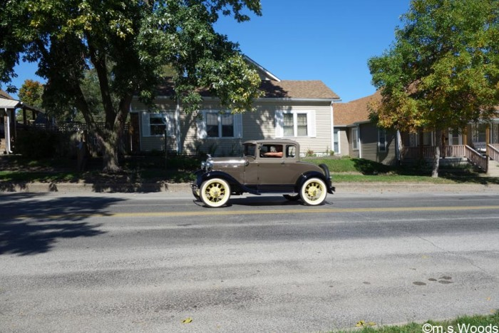 antique-car-driving-down-street-in-mooresville-indiana
