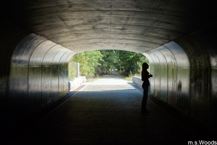person-in-b-and-o-rail-trail-tunnel