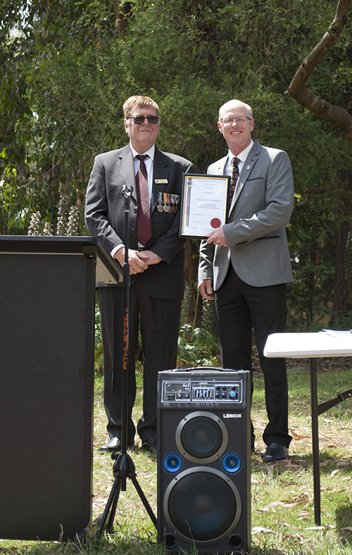Richard Schoenmaker receiving an award froom Mt Evelyn RSL