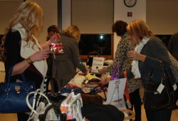 Women enjoyed shopping through tables filled with cash-and-carry purses, including an entire table of vintage and specialty purses.