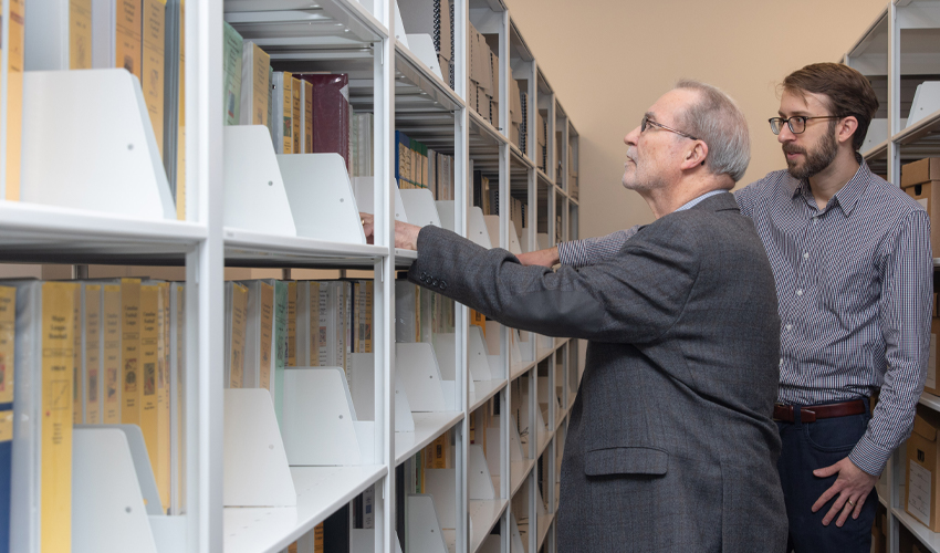 Peter Houston and Robert Blaine browse the Blaine Canadian sports history collection.
