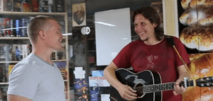 Dave talking to man with guitar