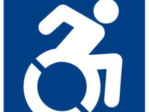 Blue and white stick figure actively wheeling a wheelchair