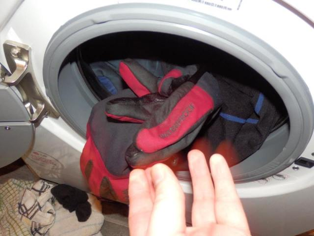 'Throw' them in the washing machine action shot.