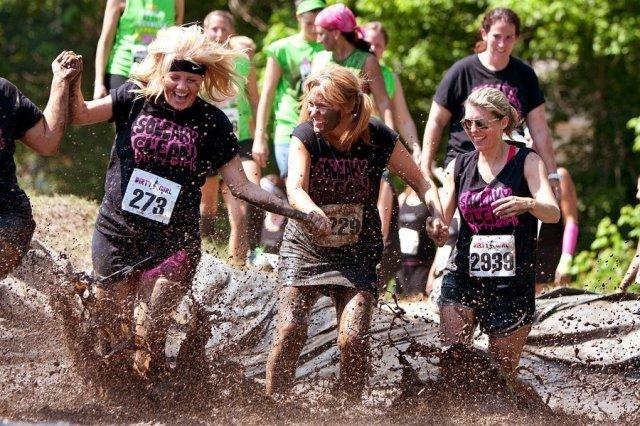 Women Splash Around In Mud Pit Of Obstacle Course Run