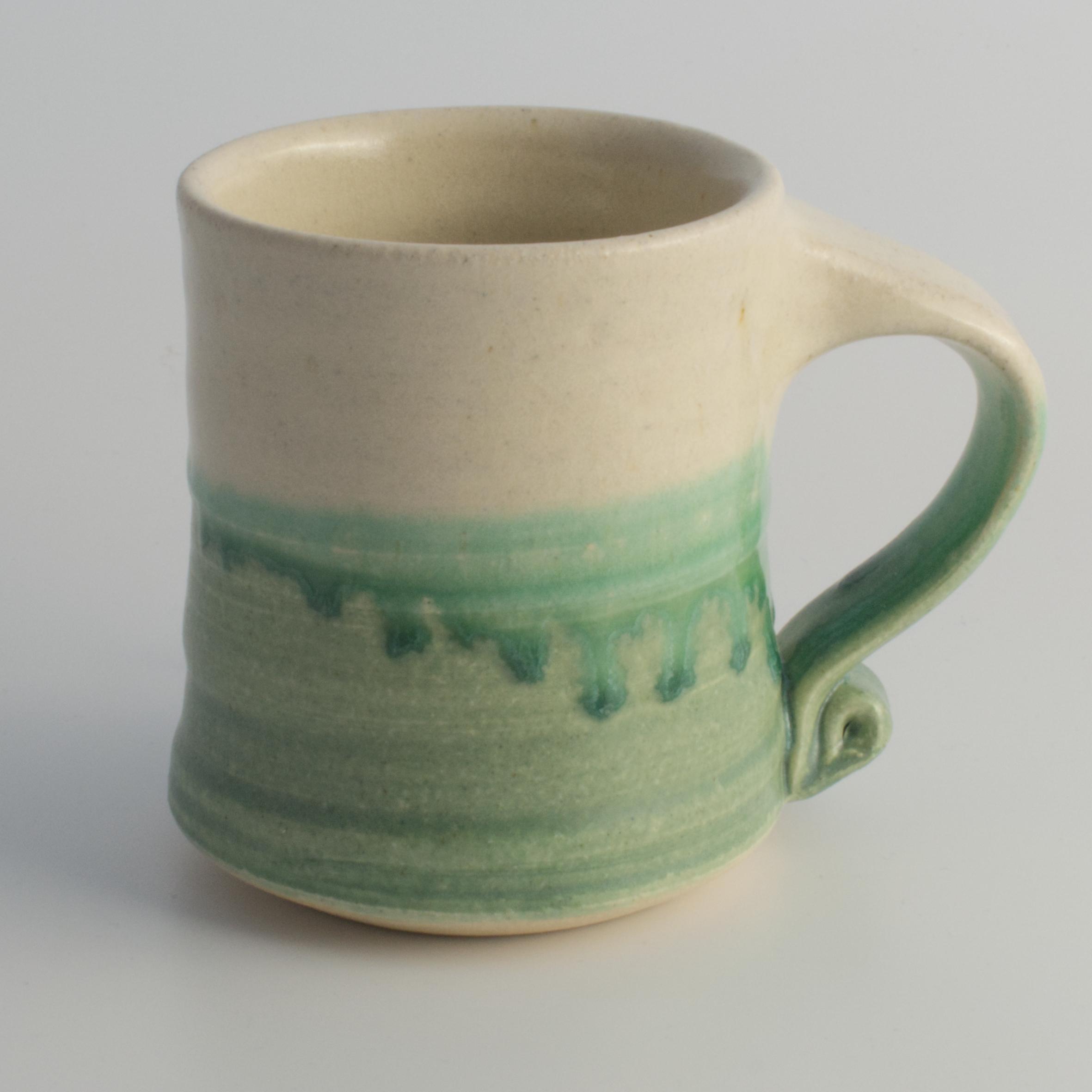 green & white ceramic mug