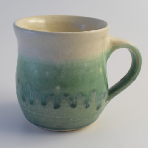 green and white stoneware pottery mug