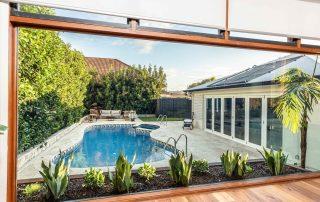 Bar Beach - Urban Oasis - Tiled Backyard Pool With Hot Tub