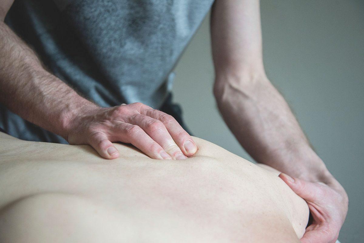 patient has back massaged