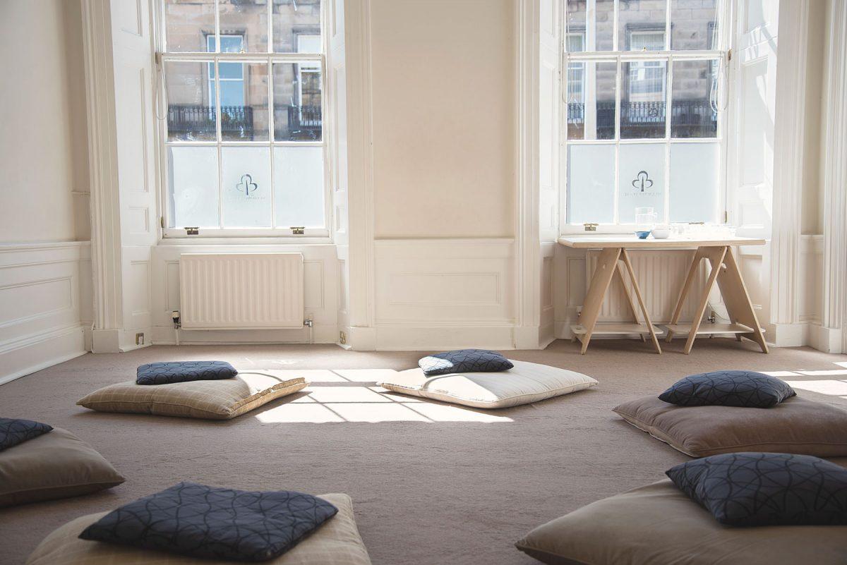studio cushions on floor for a class