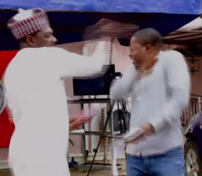 (Video) Human rights activist, Ahmed Isah of Brekete Family seen slapping a man