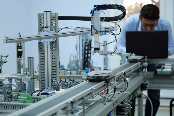 Focus on Gripper which picks up the product from an automated ca