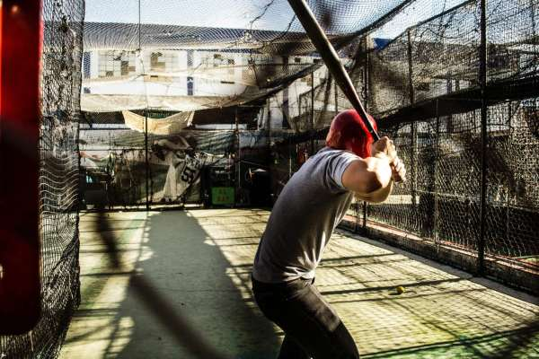 Picture of a baseball player in a batting cage