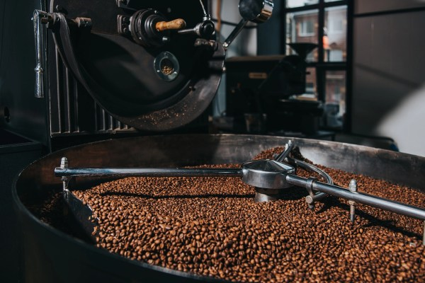 Interior of coffee production workshop with working coffee roast