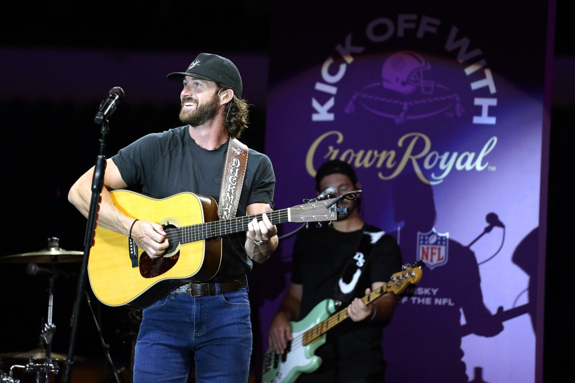 Country music star Riley Green performs at the Crown Royal Industry Night of Service Generosity Hour, celebrating hospitality and stadium workers in Dallas, Texas at AT&T Stadium.