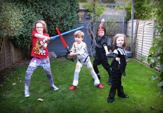 Star Wars Reads Day lightsaber practice