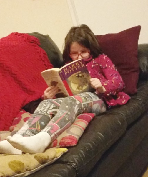 H reading Harry Potter