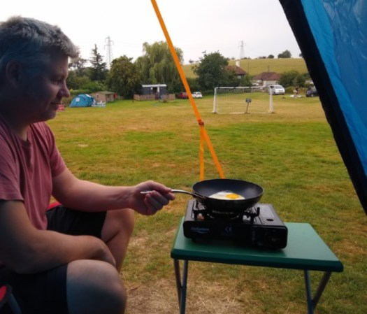 Cooking on a gas stove in the porch area of the Zenobia 6 Eclipse tent. Bought a tent