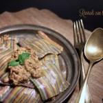 Ravioli multicolori ripieni d'anatra