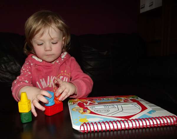 stacking her animal crayons