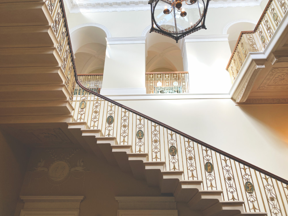 A marble balustrade on a three storey stair case at Basildon Park National Trust house