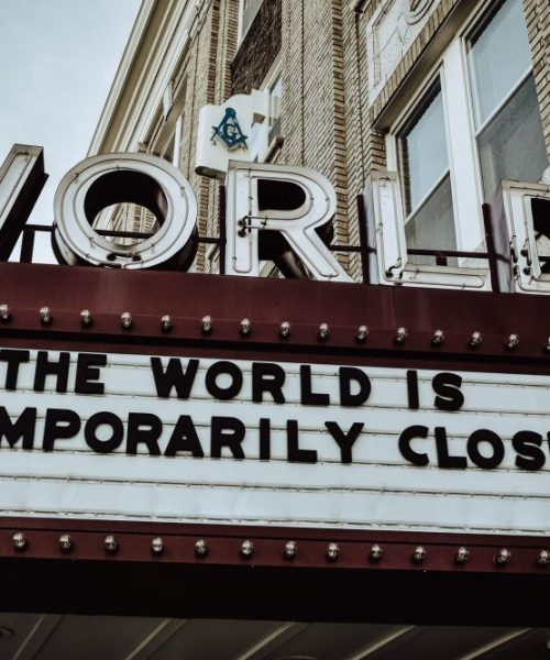 "A sign below the World Cinema saying ""The world is temporarily closed"""